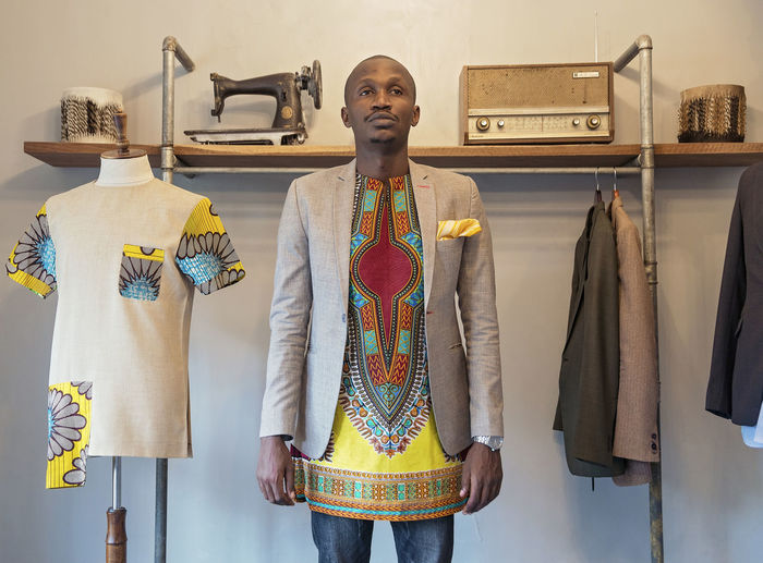 Fashion Designer African Fabric Wristwatch Blazer - Jacket Traditional Clothing Male Model Black Model Front View Indoors  Clothing Standing One Person Store Three Quarter Length Fashion Retail  Small Business Choice Variation Portrait Rack Casual Clothing Wall - Building Feature Looking Design Professional