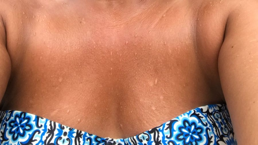Midsection Of Wet Mature Woman In Off Shoulder Dress