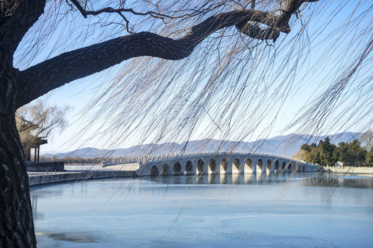 View of bridge over river during winter