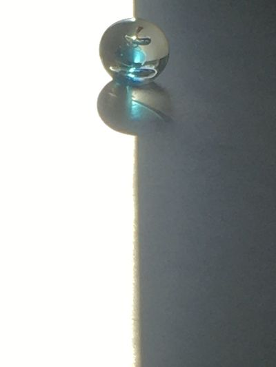 Low angle view of electric lamp against white wall
