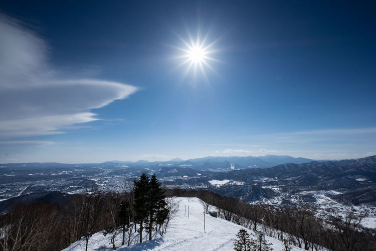 Winter Snow Cold Temperature Sky Scenics - Nature Mountain Beauty In Nature Sun Tranquil Scene Tranquility Environment Landscape Nature Non-urban Scene Mountain Range Sunlight Lens Flare Day Snowcapped Mountain No People Outdoors Bright Sapporo Hokkaido Japan