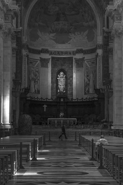 Main Church of Catania, Sicily. Religion Indoors  The City Light Sicily City Photography Architecture Full Length Real People Place Of Worship Built Structure Spirituality Architecture Pew Arch Leisure Activity Men Day People Black & White Blackandwhite Bw Blackandwhite Photography The City Light
