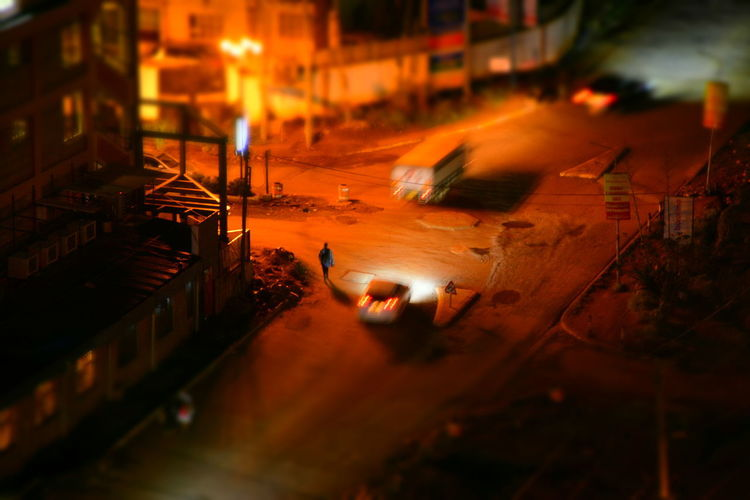 Architecture Building Exterior Built Structure City High Angle View Illuminated Motion Motor Vehicle Night Real People Road Selective Focus Street Tilt-shift Transportation Working