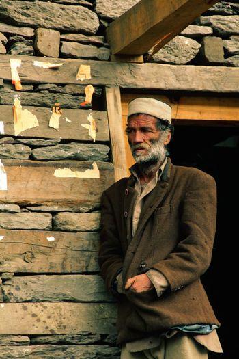 Bearded Man Standing Against House Entrance