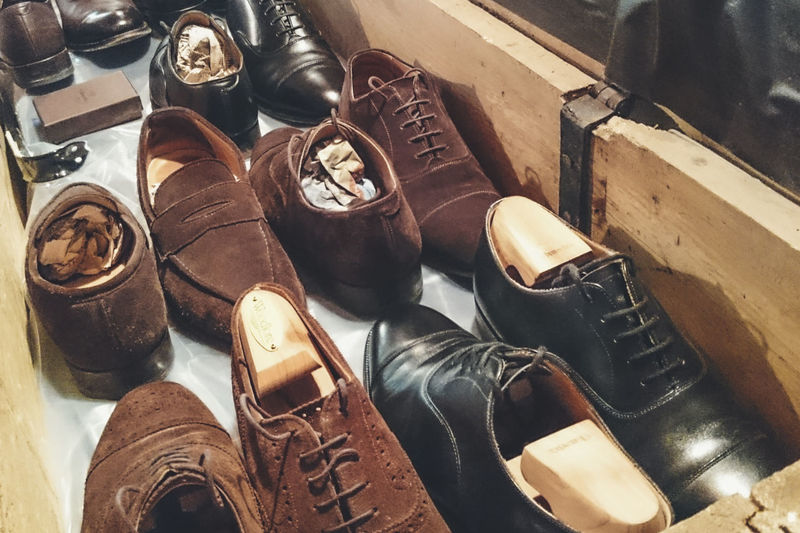 High Angle View Of Various Shoes In Drawer