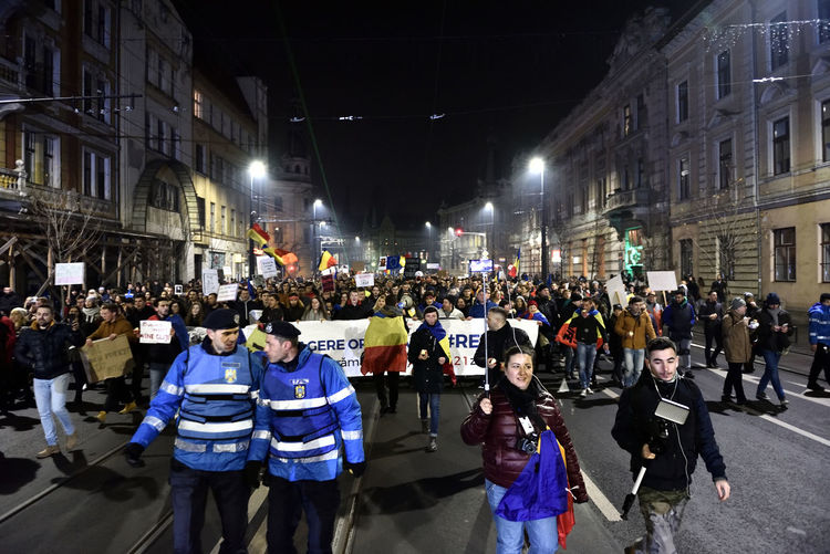 CLUJ NAPOCA, ROMANIA - FEBRUARY 4, 2017: More than 50,000 people protesting against the Romanian Government's plans to pardon or reduce sentences of corrupt politicians, the Amnesty law and the Prime Pinister Amnesty Civil Rights  Cluj-Napoca Corruption Crowd Crowded Crowded Street Crowds Demonstration Liviu Dragnea Marching Mass People Police Politics Politics And Government Protest Protesters Revolution Riot Romania Socialist Party Sorin Grindeanu Street Thousands