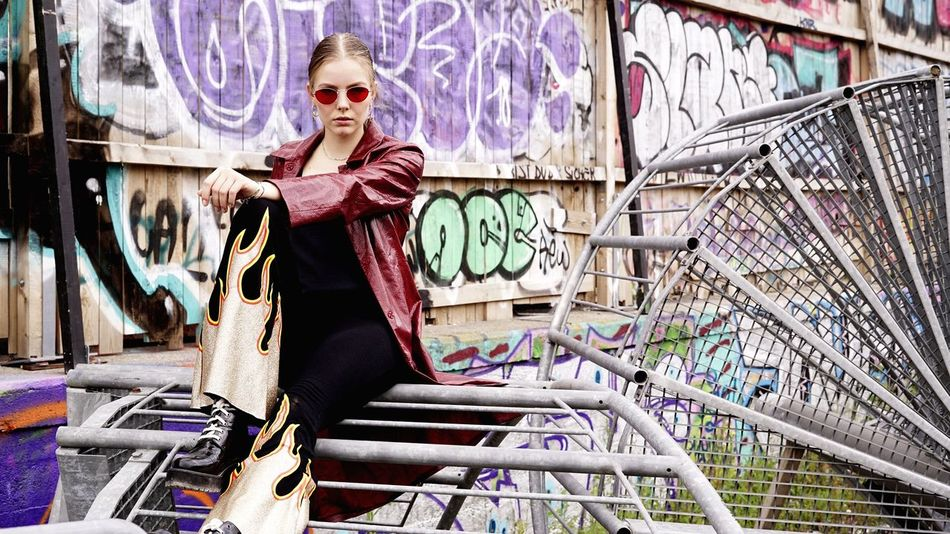One Person Architecture Glasses Graffiti Portrait Fashion Art And Craft Built Structure Lifestyles Looking At Camera Full Length Adult Sunglasses Real People Front View Outdoors Standing Clothing Young Adult