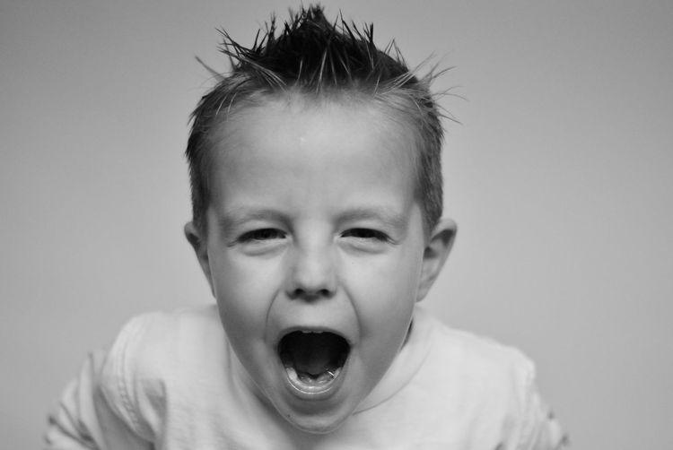 Close-up portrait of boy shouting