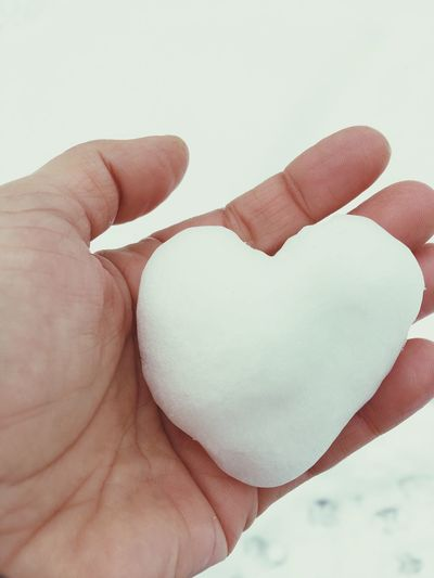 Snow Human Hand Hand Human Body Part Finger Human Finger Holding One Person Unrecognizable Person Positive Emotion Love Creativity Indoors  Emotion Close-up Lifestyles Body Part Heart Shape Real People Personal Perspective