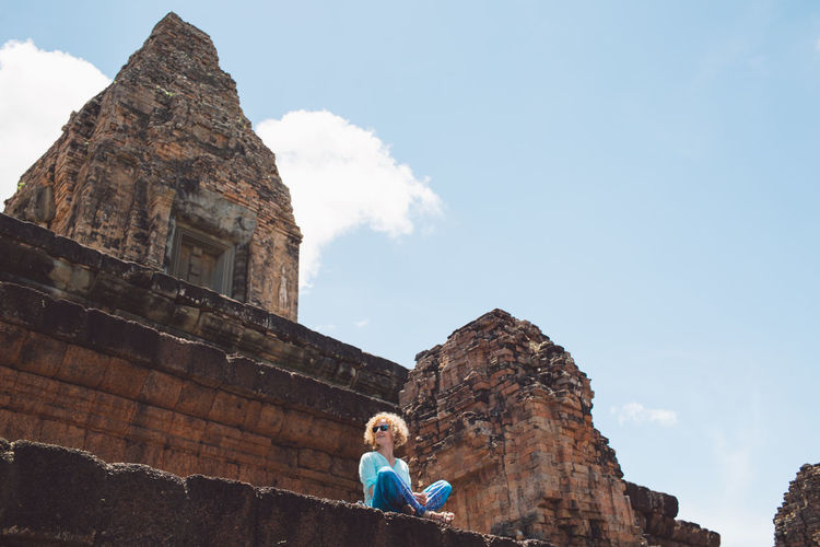 Cambodia Siem Reap Ancient Civilization Angkor Architecture Building Exterior Built Structure Curly Hair Day Girl History Leisure Activity Lifestyles Nature One Person Outdoors Real People Religion Sky Solid Spirituality The Past Tourism Travel Travel Destinations Women