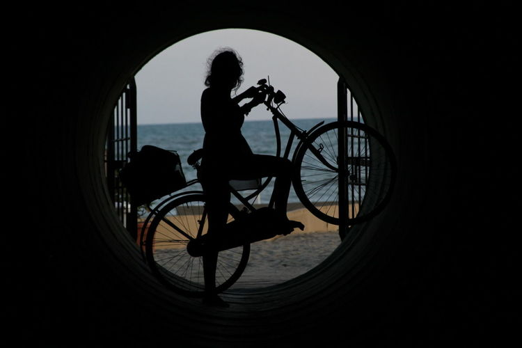 Bicycle Day Full Length Land Vehicle Lifestyles Mode Of Transport One Person Outdoors Real People Side View Silhouette Sky Transportation Women