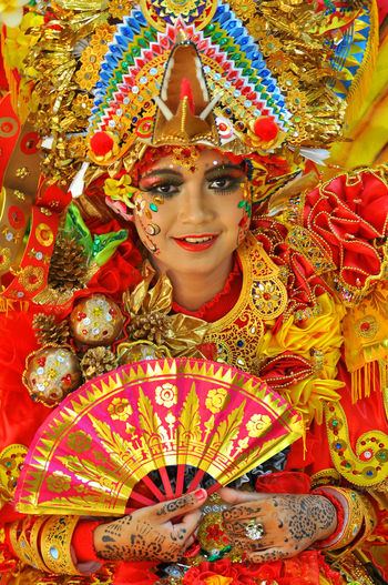 Woman with multi colored umbrellas