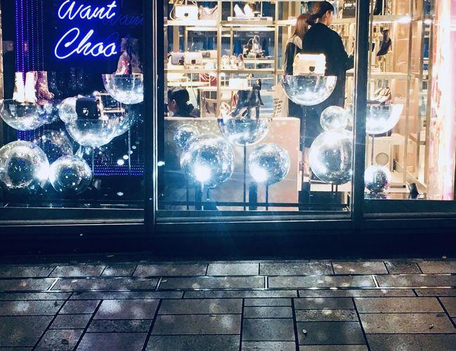 Illuminated text on glass window at night