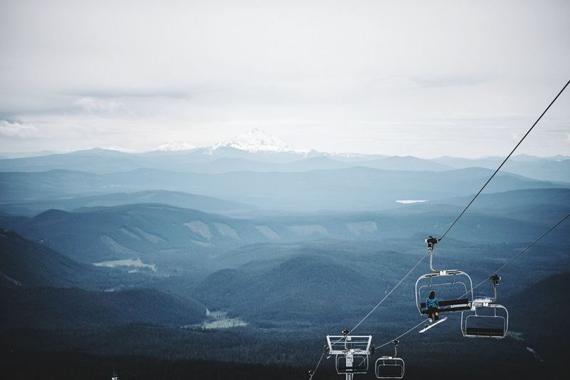 Mountain Fog Mountain Range Scenics Nature Overhead Cable Car Day Outdoors Ski Lift Beauty In Nature Landscape No People Travel Destinations Tranquility Vacations Glacier Sky Adventure Nautical Vessel Tree