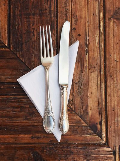 Directly above shot of fork and knife on table