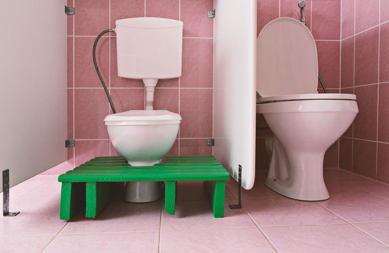 Absence Architecture Bathroom Built Structure Childern Clean Convenience Domestic Bathroom Domestic Room Flooring Home Hygiene Indoors  No People Public Restroom Seat Tile Tiled Floor Toilet Toilet Bowl Urgency Wall - Building Feature