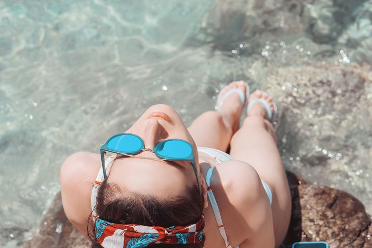Beach One Person Water Nature Holiday Land Vacations Sunlight Trip Real People Sand Sea Relaxation Women Leisure Activity Day Human Body Part Lifestyles Outdoors Swimming Pool Moments Of Happiness
