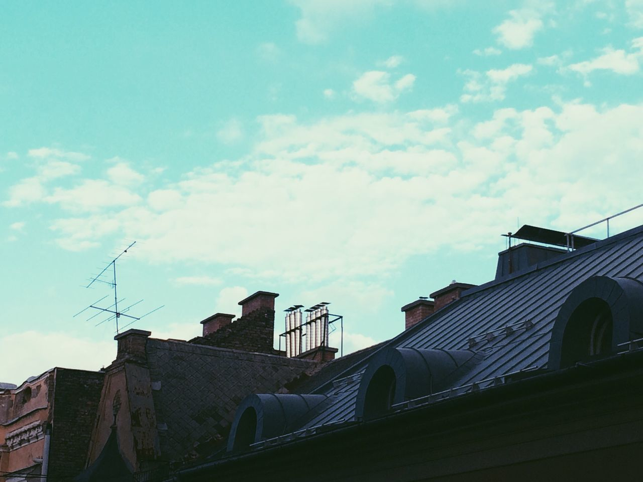 High section of houses against sky