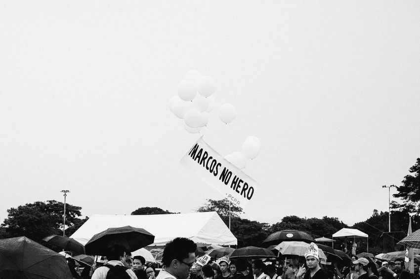 March of the Militant Minds | Marcos Balloons About to Pop Politics Politics And Government Black Friday Eyeem Philippines Crowd Rally Protest Banner - Sign Text Words Communication Photojournalism Street Photography Streetphoto_bw Balloons Floating Black And White Black & White Black And White Photography Monochrome Monochrome Photography Noir Eyeemphoto Resist