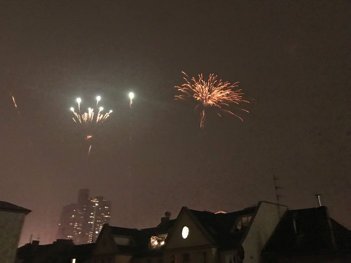 Fireworks. Happ Neujahr Feuerwerk Happy New Year New Year Night Illuminated Firework Celebration Event Motion Exploding Low Angle View Firework Display No People City Building Exterior