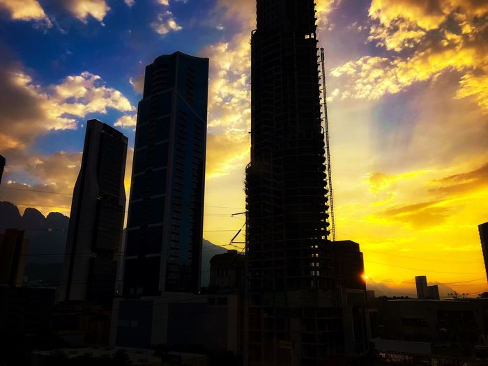 Sunset Sunset Sky Architecture Built Structure Building Exterior Cloud - Sky Building Skyscraper Modern Low Angle View Outdoors Sunlight Silhouette Tall - High Tower Orange Color Office Building Exterior Nature City No People