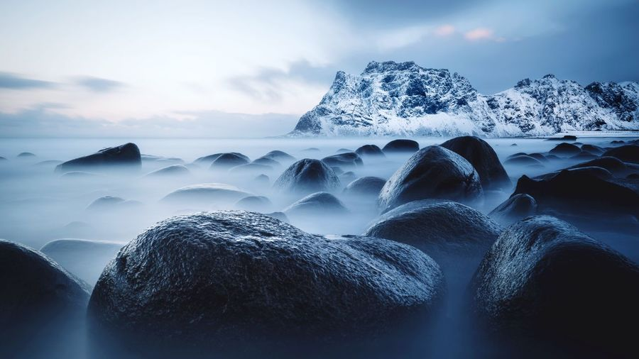 Rocks in sea during winter