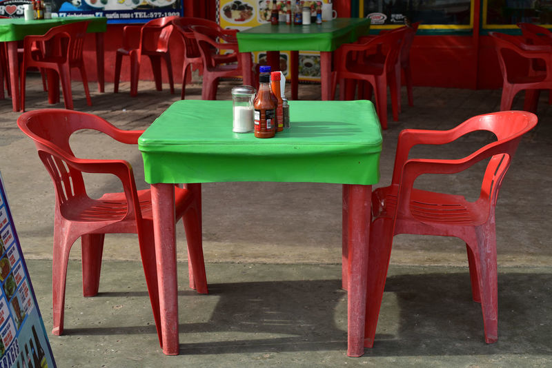 restaurant table in Baja, Mexico Hot Sauce Mexico San Felipe Baja Condiment Bottle Day Green Color Mexican Colors Mexican Restaurant No People Red And Green Table Table And Chairs Tablecloth