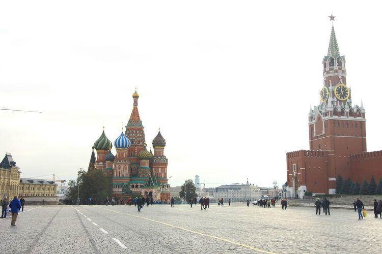 The view St. Basil cathedral and Spasskaya Tower of Kremlin Wall from the centre of Red Square. Moscow Moscow City Moscow, Russia Red Square Moscow Russia St. Basil Cathedral And Spasskaya Tower Of Kremlin Wall Travel Architecture Clock Tower Saint Basil's Cathedral Spasskaya Tower Tourism Tower Travel Destination Travel Destinations