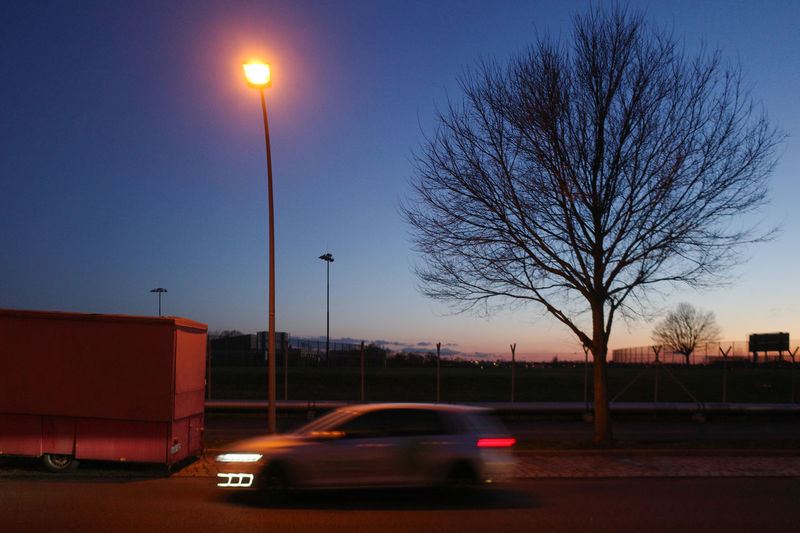 Cars on road at dusk