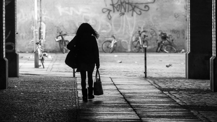 Black And White Street Photography Silhouette Real People One Person Rear View Walking Full Length City Women Street Lifestyles Footpath Day Adult Architecture Outdoors Built Structure Sidewalk Incidental People Building Exterior Leisure Activity Warm Clothing Streetwise Photography