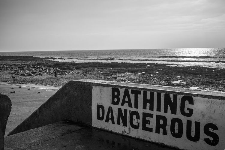 No Bathing Porthcawl South Wales Beach Beauty In Nature Coastal Communication Danger Day Horizon Over Water Monochrome Nature No People Outdoors Scenics Sea Sea View Sky Text Tranquility Warning Sign Water