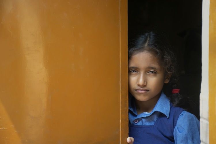 Portrait of girl standing at entrance