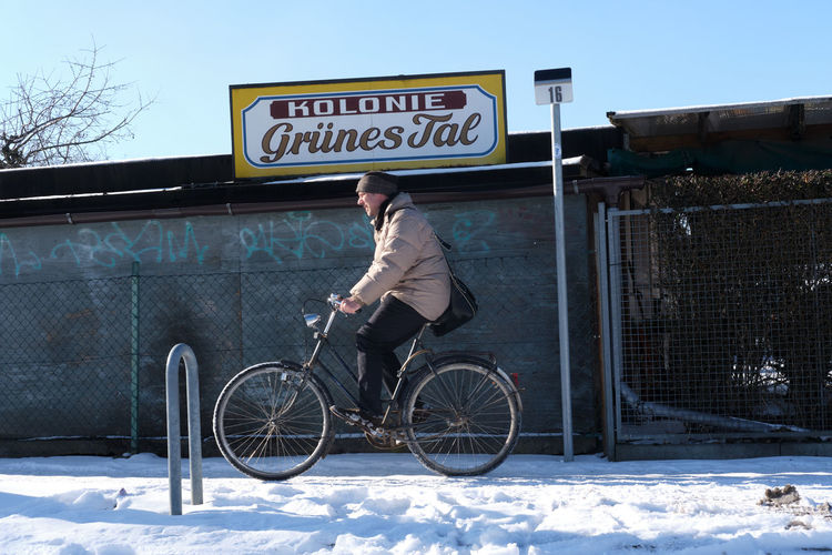 Man riding bicycle in winter