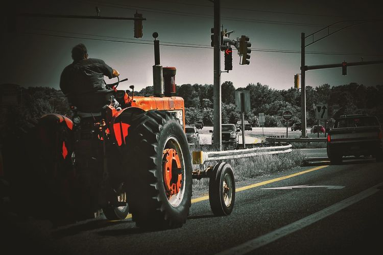 Exiting the fast lane Farming Urban Farming Tractor On The Road Streetphotography Freeway Rural America Rural Scenes Road Street Photography