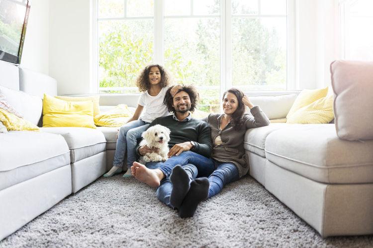 Portrait of friends sitting on sofa