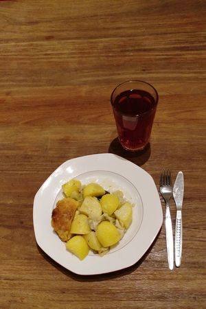 Plate Food And Drink Table Food Freshness Indulgence Healthy Eating No People Wood - Material Drinking Glass Ready-to-eat Drink Day Close-up Kartoffeln Potatoes Schnitzel Cordon Bleu Wooden Table Cutlery Fork Knife German Food Tea Food And Drink
