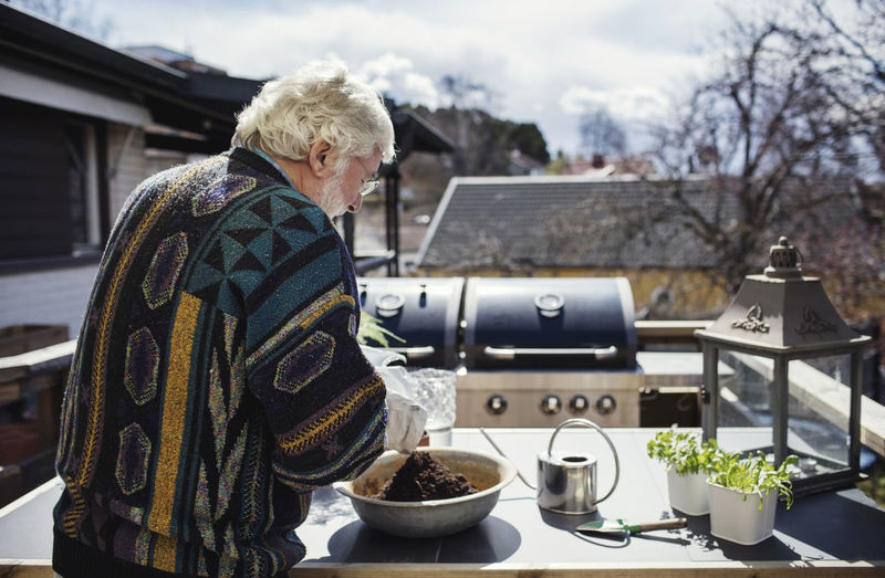 Midsection of woman standing by food outdoors