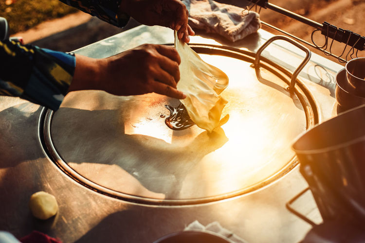 Cropped image of hand making roti