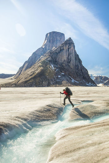 Man surfing on mountain against sky