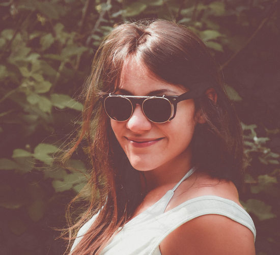 Beautiful Woman Day Fashion Focus On Foreground Glasses Hair Hairstyle Headshot Leisure Activity Lifestyles Long Hair Looking At Camera Nature One Person Outdoors Portrait Real People Smiling Sunglasses Women Young Women