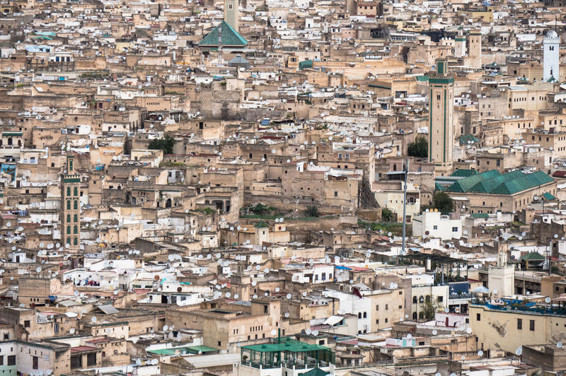 Medina of Fes is a maze. No cars allowed with lots of hidden riads. I really enjoyed the details. Fes Medina Architecture Building Exterior Built Structure City Cityscape Community Crowd Crowded Day Full Frame High Angle View House Medina De Fez Nature Outdoors Residential District Roof Town TOWNSCAPE Travel Destinations Urban Sprawl