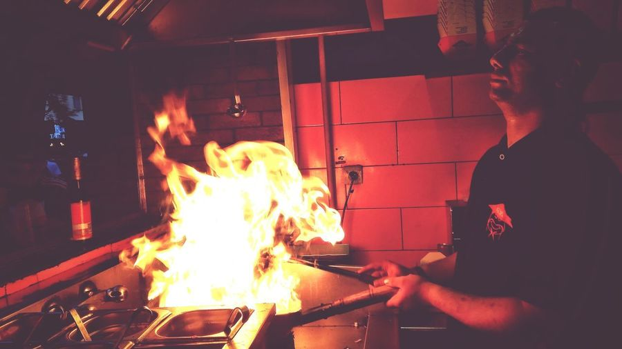 Heat - Temperature Food And Drink Establishment Preparation  Adults Only Flame Adult Business Finance And Industry Only Men Commercial Kitchen Indoors  People One Man Only Food One Person Chef Men Working Human Body Part Metal Industry Human Hand