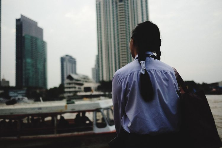 EyeEm Selects City Skyscraper Building Exterior Architecture Built Structure Real People Rear View Men Cityscape One Person Outdoors Modern Day Well-dressed Sky Adult People