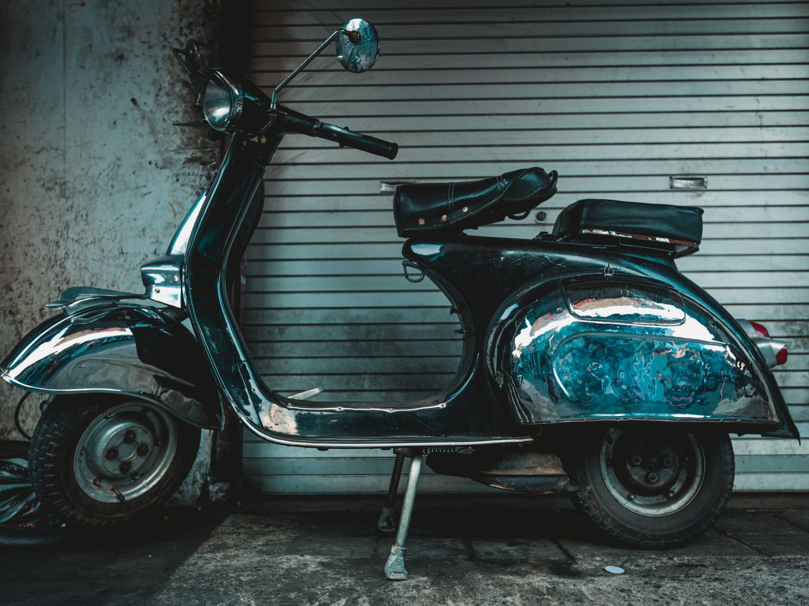 mode of transportation, transportation, land vehicle, stationary, retro styled, no people, metal, old, motor vehicle, scooter, headlight, vintage car, day, car, architecture, vintage, wall - building feature, abandoned, blue, outdoors, garage, wheel, chrome