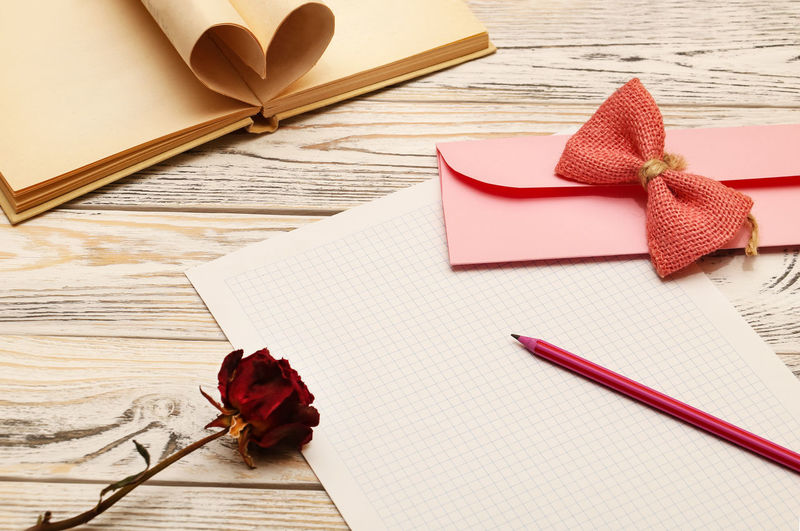 Happy Valentines Day ;) Valentine's Day  Valentine's Day Card Table Paper Still Life Book No People Indoors  Ribbon - Sewing Item Flower High Angle View Page Wood - Material Flowering Plant Creativity Note Pad Heart Shape Envelope Copy Space