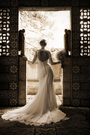 Rear View Of Bride Standing In Doorway