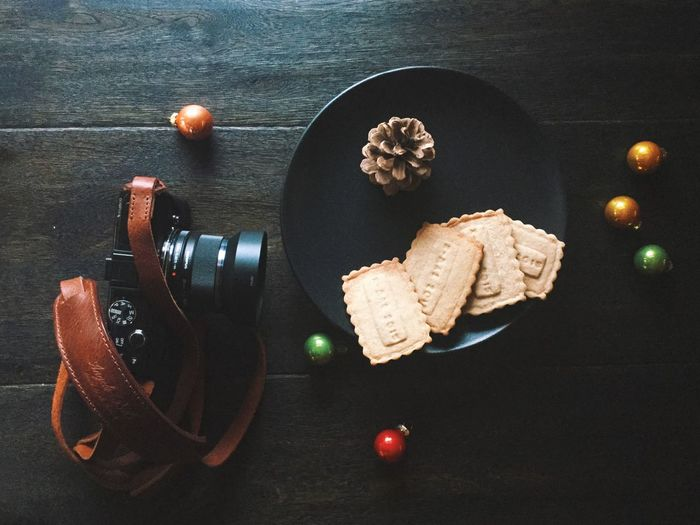High Angle View Of Cookies In Plate By Camera On Table