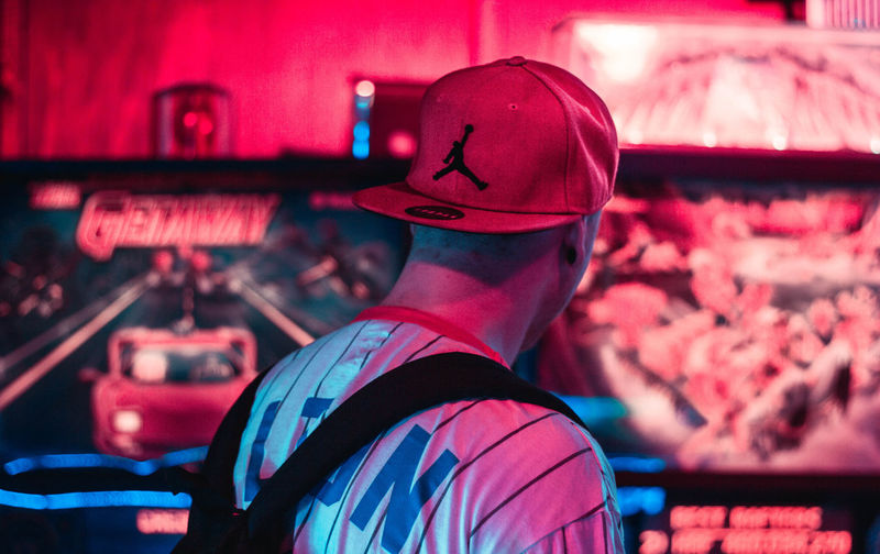 Rear view of people at illuminated nightclub