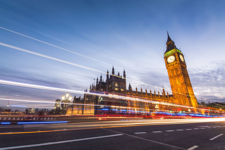 Architecture Blurred Motion Bridge - Man Made Structure Building Building Exterior Built Structure City City Life Cityscape Clock Clock Tower Gothic Style Government Illuminated Light Trail Long Exposure Motion Night No People Outdoors Sky Speed Tower Transportation Travel Destinations