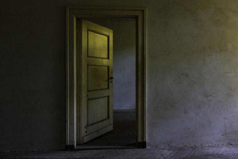 Opened Door Of Abandoned Building